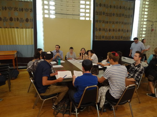 COLD: Rabbi Schwarzberg's 12th grade Gemara class learns in the JCC auditorium during heat wave week. Juniors and seniors were split up among the air conditioned rooms downstairs due to the temperature.