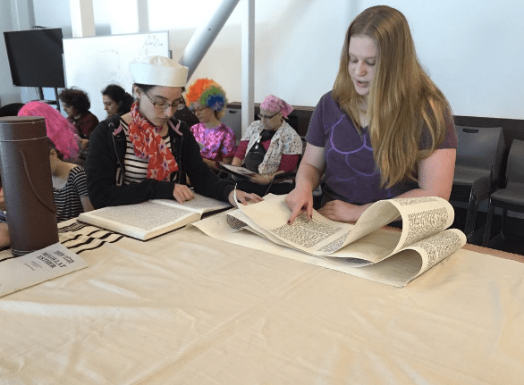 HISTORY: From top, freshman Abby Blumofe and alumna Sara Smith '04 read from Megillat Esther.