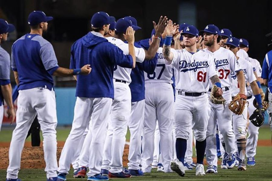 DODGERS%3A+Players+rejoice+after+their+9-3+victory+over+the+Padres+on+September+25.