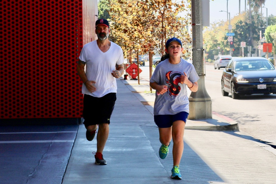 DASH: Members of the running club ran by the Peterson Museum at Wilshire and Fairfax Oct. 27.