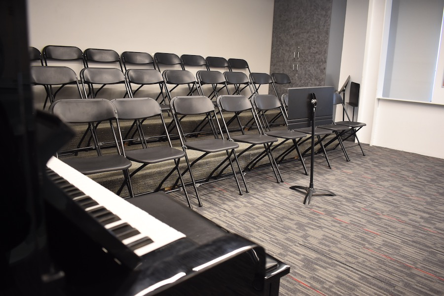 RENOVATION%3A+Risers%2C+a+carpet+and+a+new+piano+were+added+to+the+music+room+over+the+past+year.+The+choir+practices+there+twice+a+week%2C+and+singers+report+they+can+see+and+hear+better.