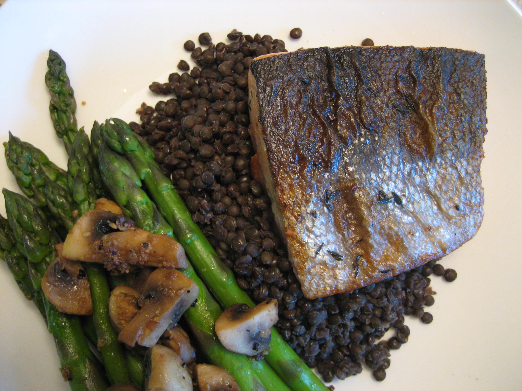 Seared Sockeye Salmon with Beluga Lentils and Asperagus Saute