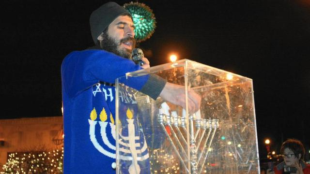 Rabbi Yochanan Posner of Lubavitch Chabad in Skokie lights the menorah of Hanukkah during the communitywide Menorah Lighting event Wednesday, Dec. 28, 2016 at Krier Plaza in downtown Skokie. (Karie Angell Luc / Pioneer Press)