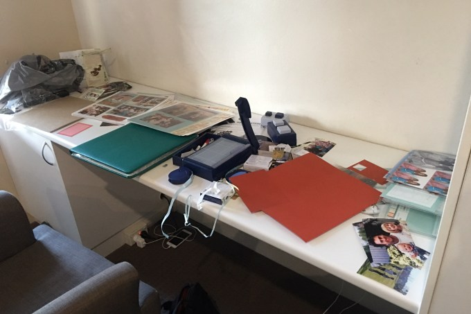 A messy scrapbooking desk