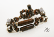 A wooden and silver plated brass bracelet with wooden clasp.