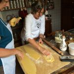 Nancy and Cathe prepare the pasta for cutting.