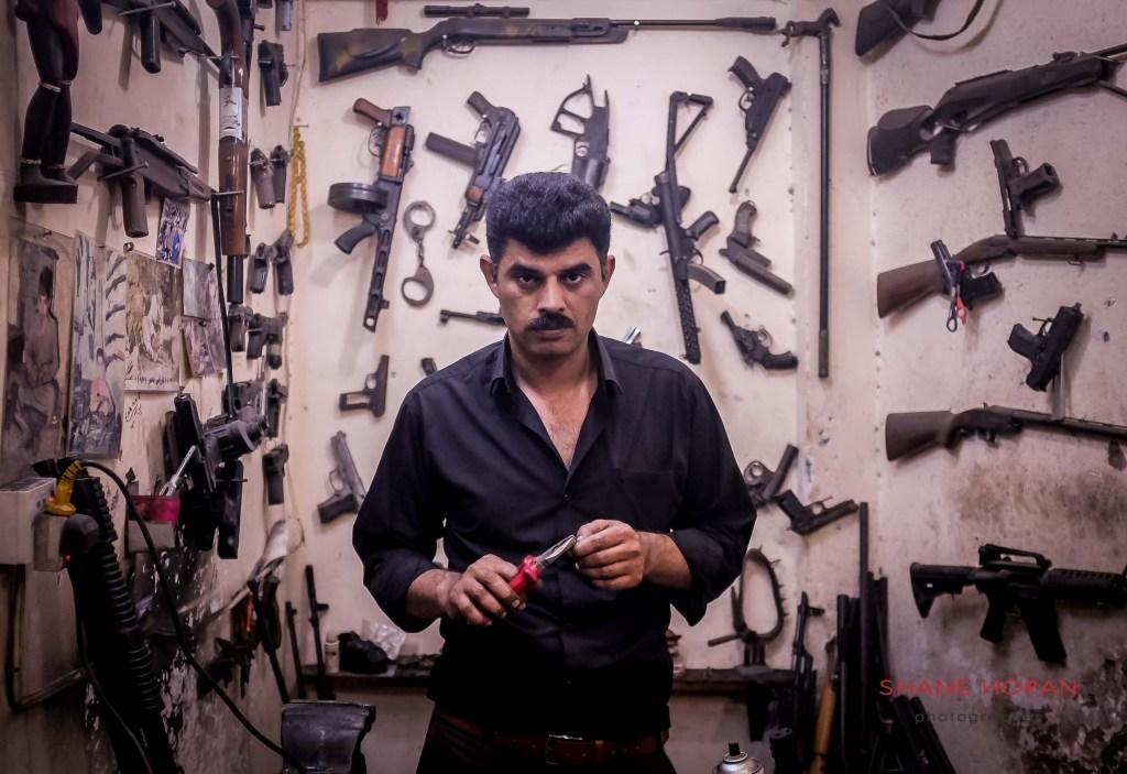 Weapon repair shop owner, downtown Erbil, Iraq