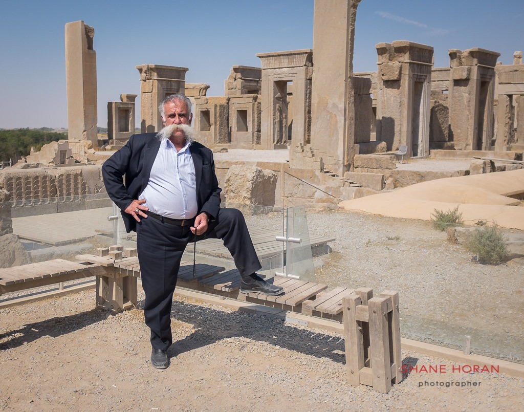Visitor posing at the Persepolis site, Iran.