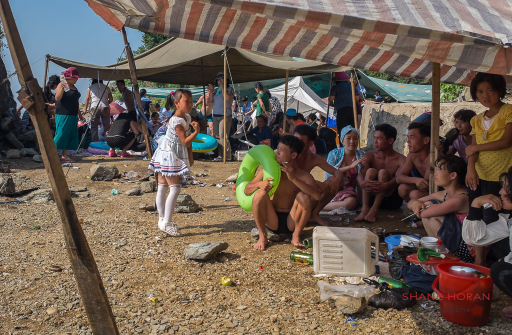 North Korean girl entertains her family at Nampo Beach, North Korea