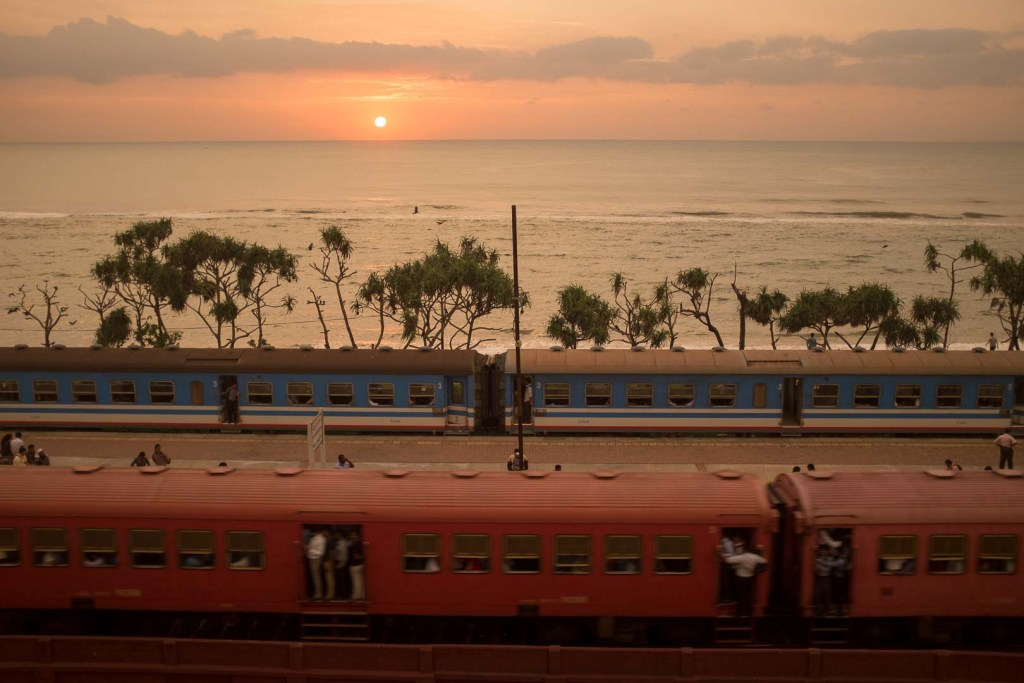 Passing trains outside Colombo, Sri Lanka.