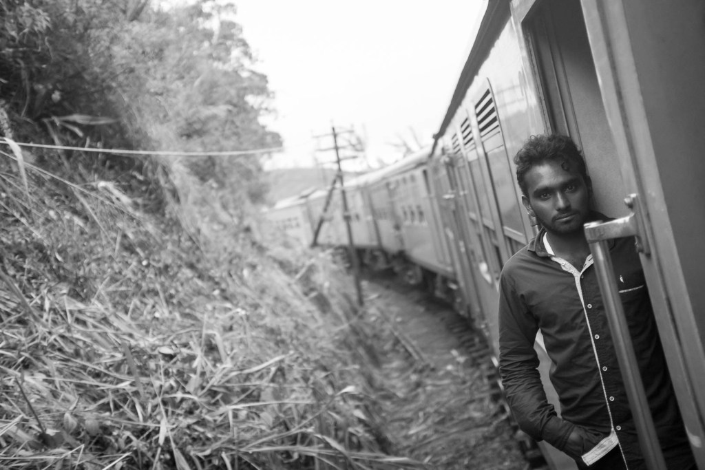 Casual train door pose, Sri Lanka.