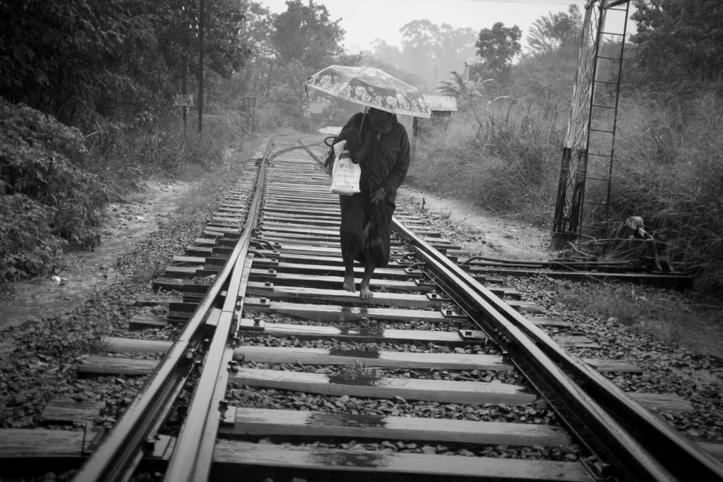 Local makes her way along the tracks, Sri Lanka.