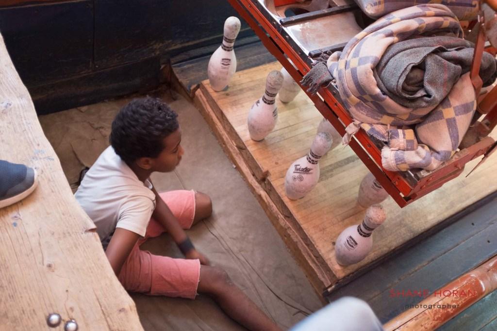 Kid worker at the Asmara Bowling Center, Eritrea.