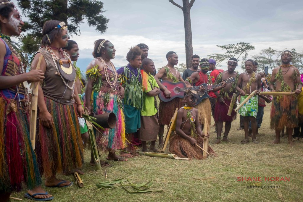 At a Papua New Guinea village, locals perform