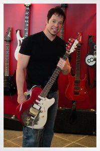 Shane Regal with custom C.R Alsip Guitar