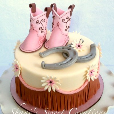 Pink baby boots and horseshoes cake