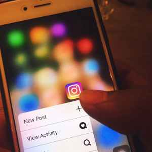 Someone posting to Instagram, proving social media is important for business