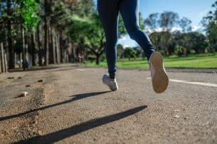 A woman jogging on pavement.
