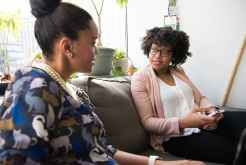 two women sitting on couch sharing how to find customers