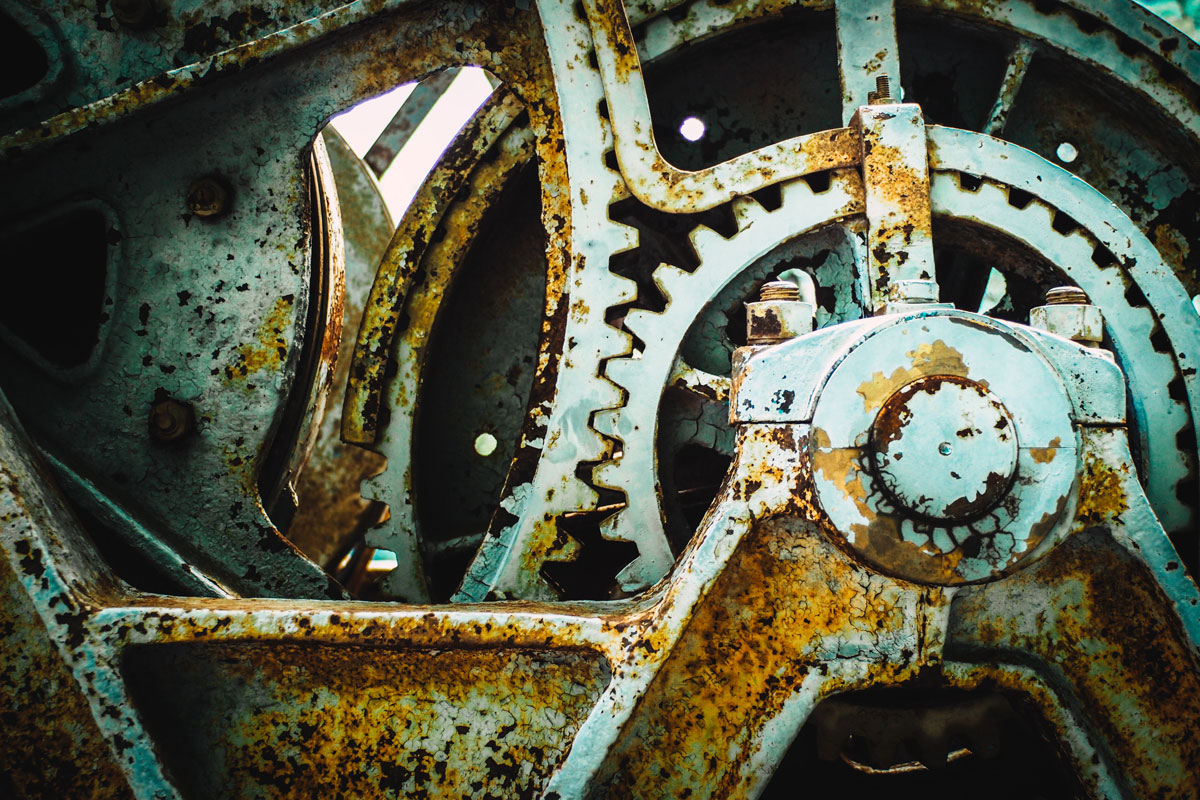 Close up of large, patinated, industrial gears