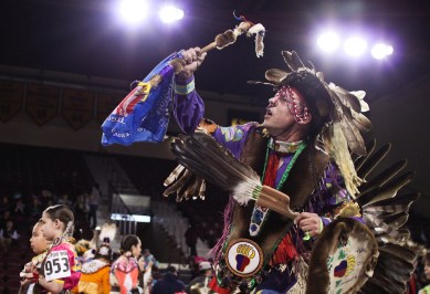 Jefferson Ballew, from Pakagon Band Potawatomi dances in a large circle at the 25th Annual Celebrating Life Pow Wow in McGuirk Arena Sunday, March 23, 2014.