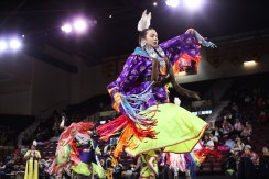 Youth compete in the women's fancy category at the 25th Annual Celebrating Life Pow Wow in McGuirk Arena Sunday, March 23, 2014.