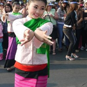 Dancer smiling at the Chiang Mai Flower Festival, Thailand
