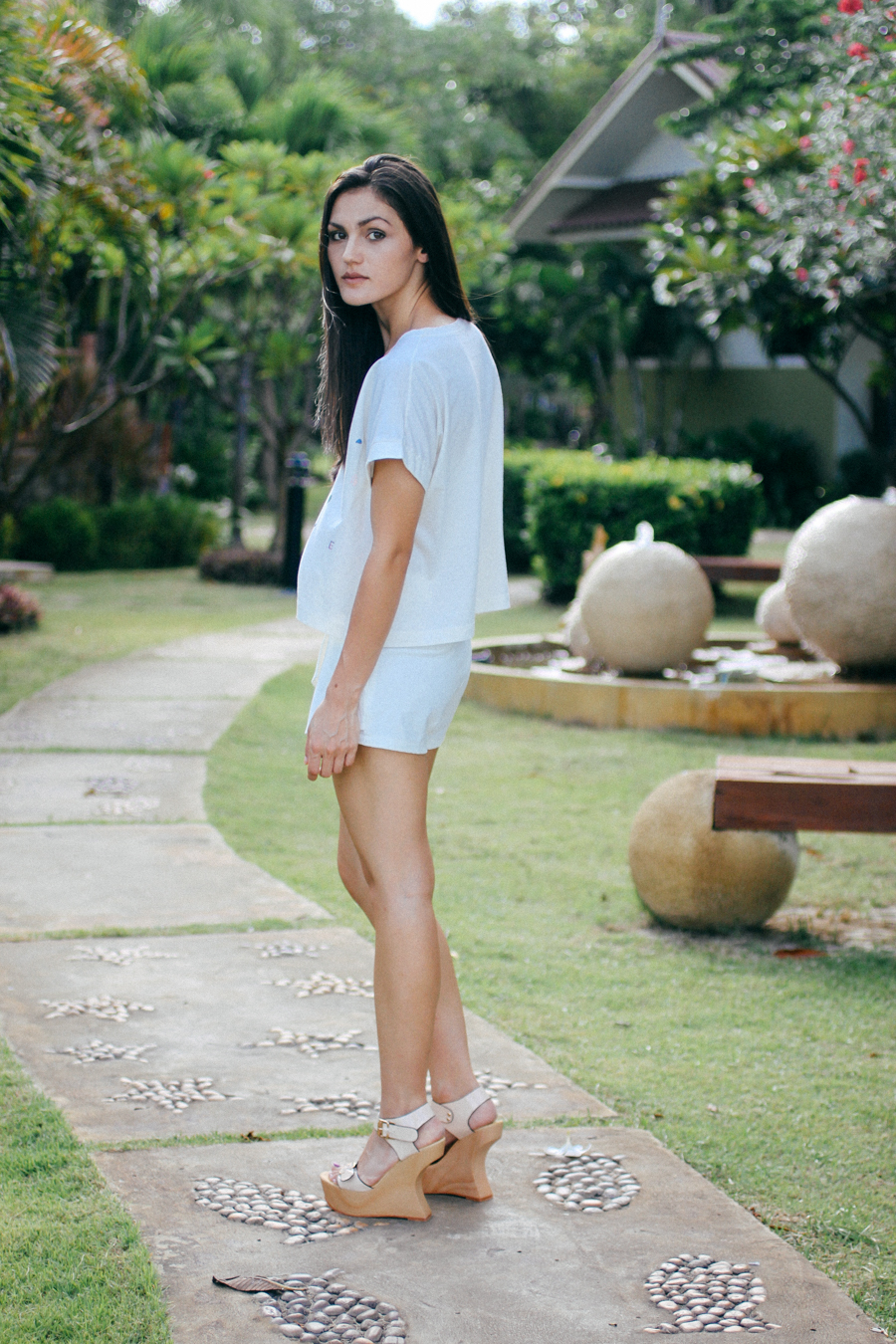 All white outfit. White skort, white top. Monochrome beach style.