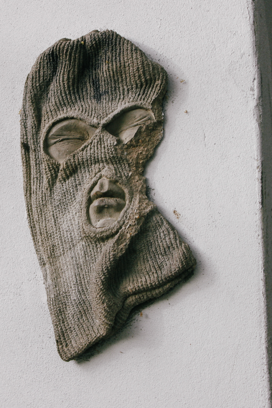 Quirky street art glove with a face in Sydney.