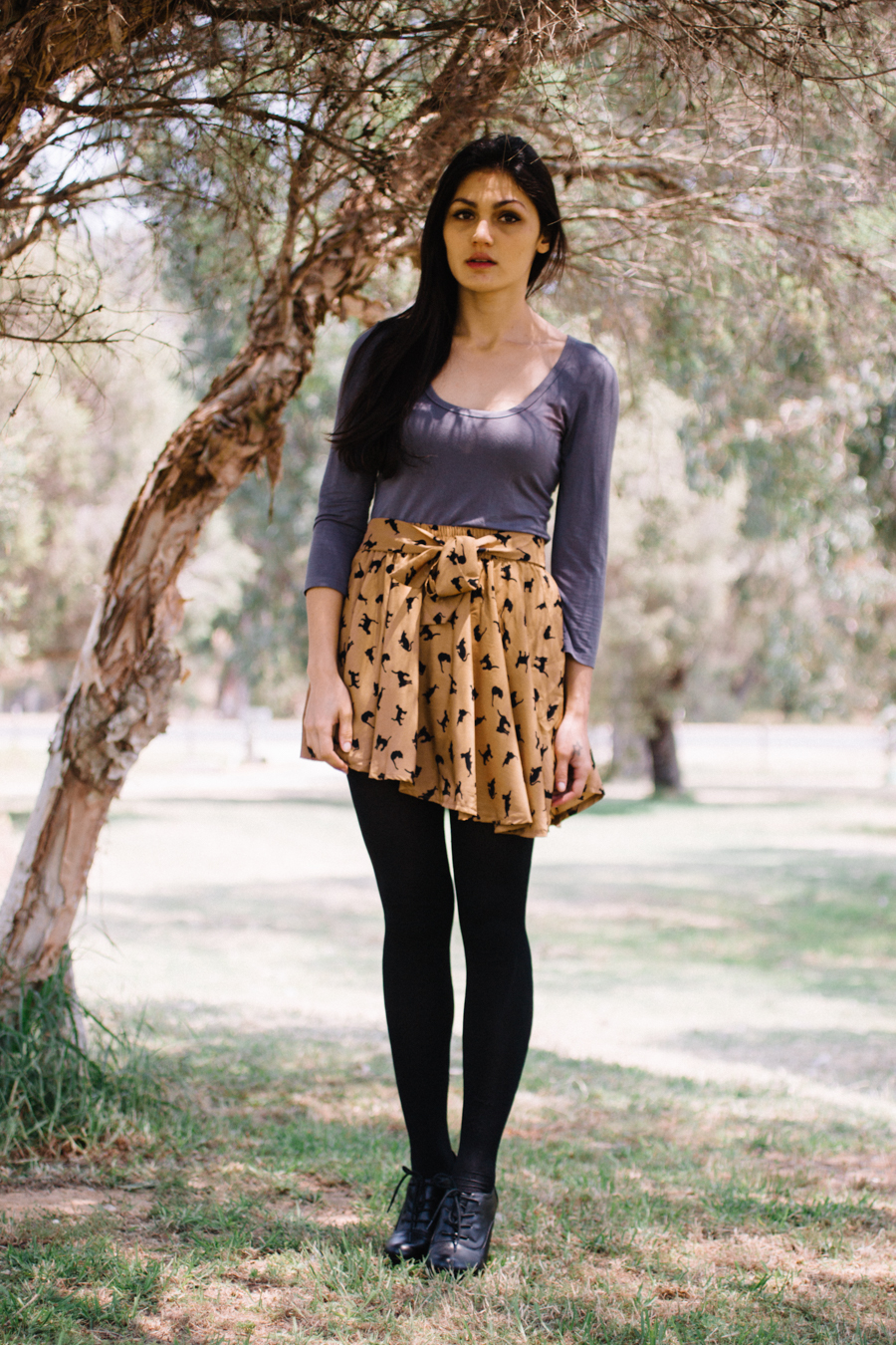 Cat print shorts skirt. Leggings with ankle boots.