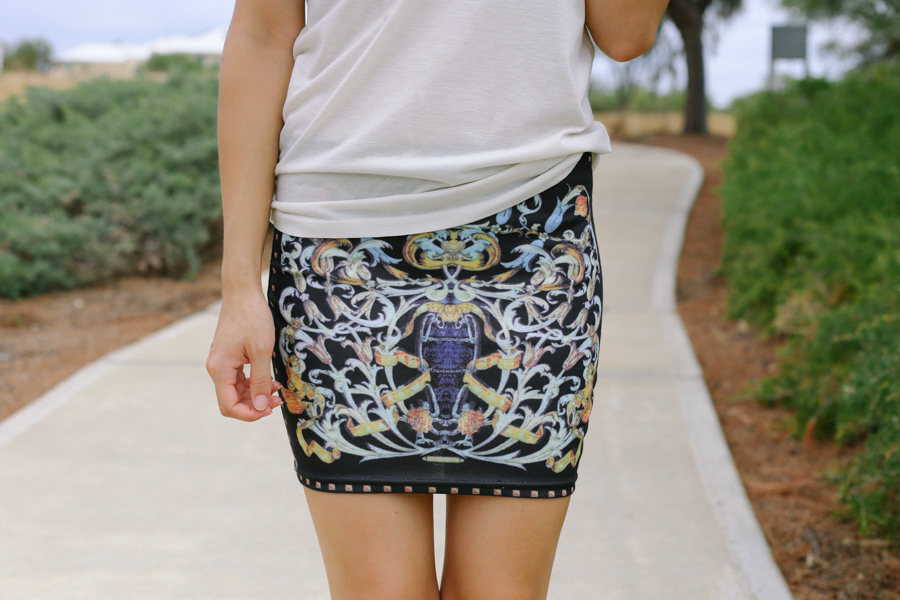 Seams Theory baroque print mini skirt.