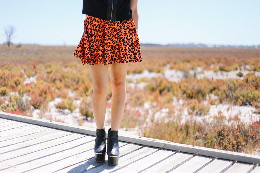 Orange geometric skirt from Seams Theory.