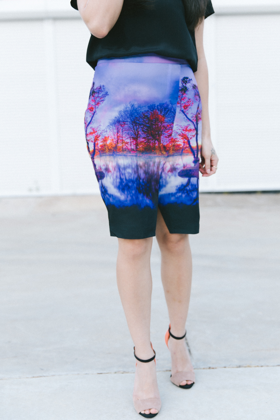 Statement print skirt with leather jacket over the shoulders. FATE clothing skirt.