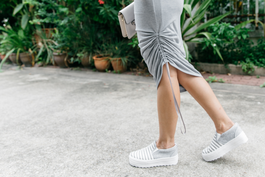 POL clothing canyon skirt & grey striped platform sneakers.