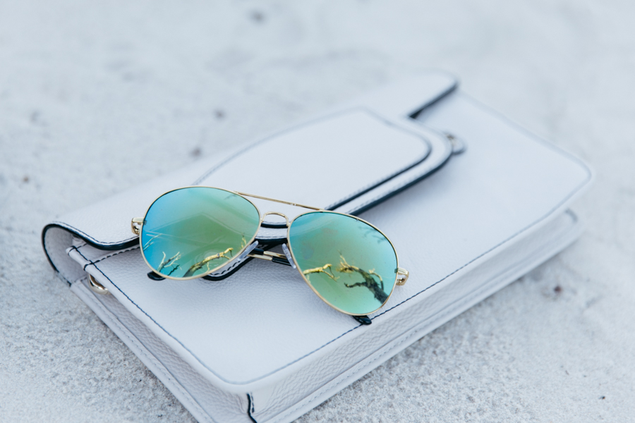 ZeroUV reflective aviator sunglasses with gold frames.