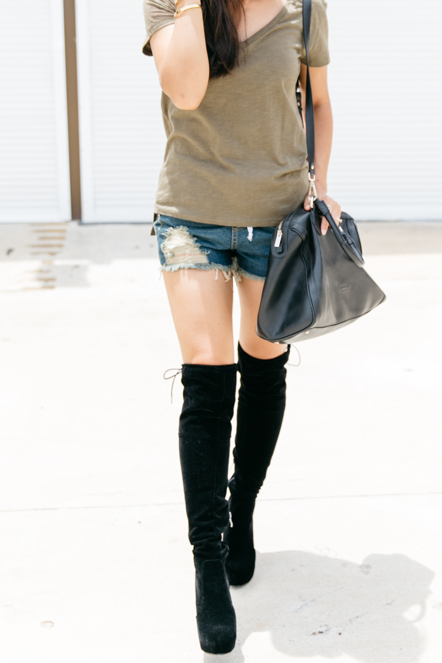 Black suede over the knee boots with denim shorts & a khaki tee.