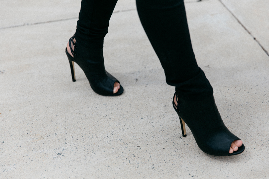 Boohoo.com lace up ankle boots in black leather.