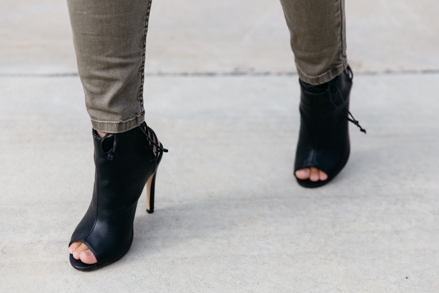 Lace up black ankle boots.