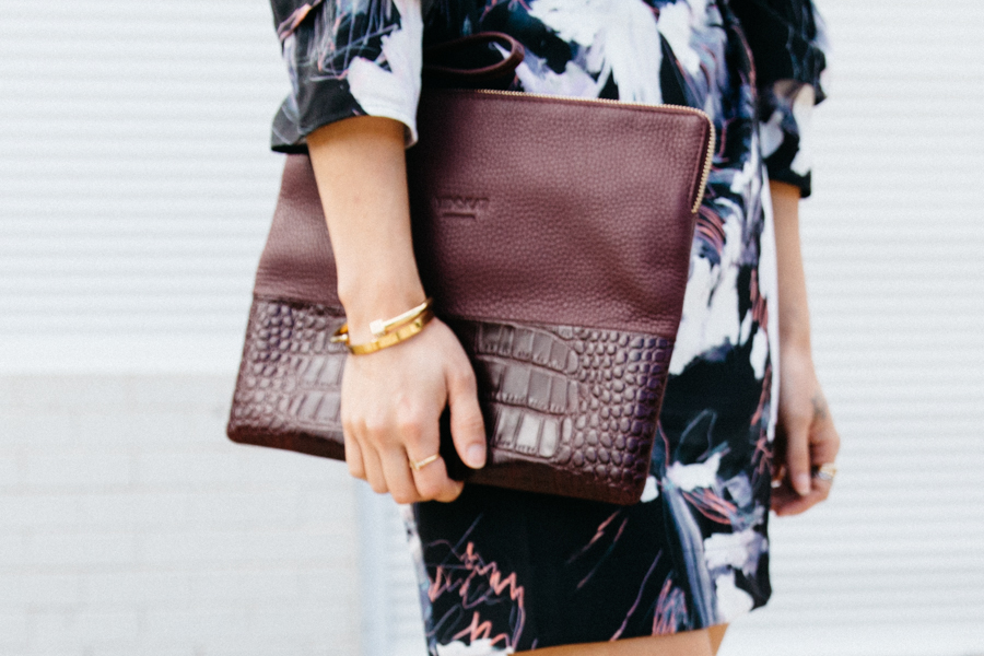 Ox blood leather clutch.