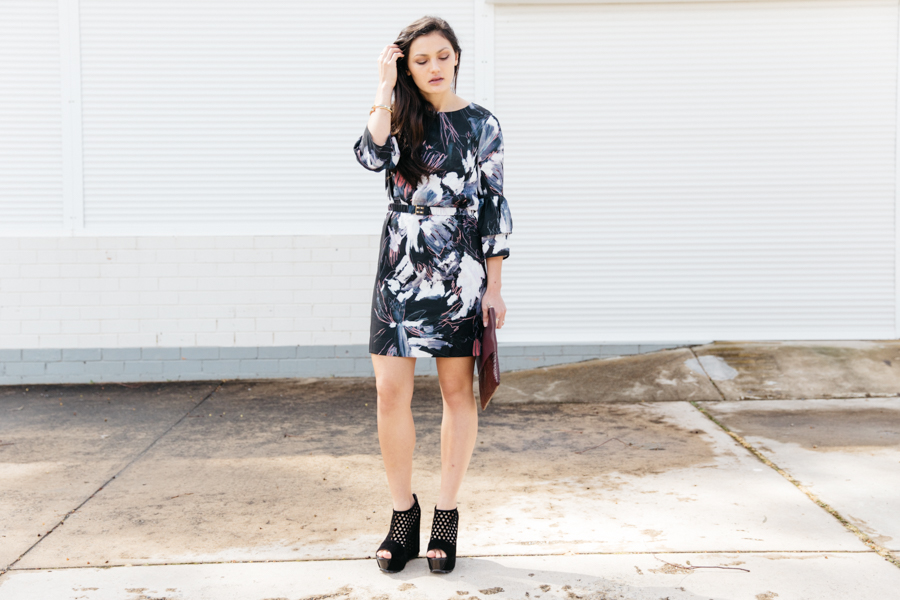 Modern floral print mini dress with wedge ankle boots.