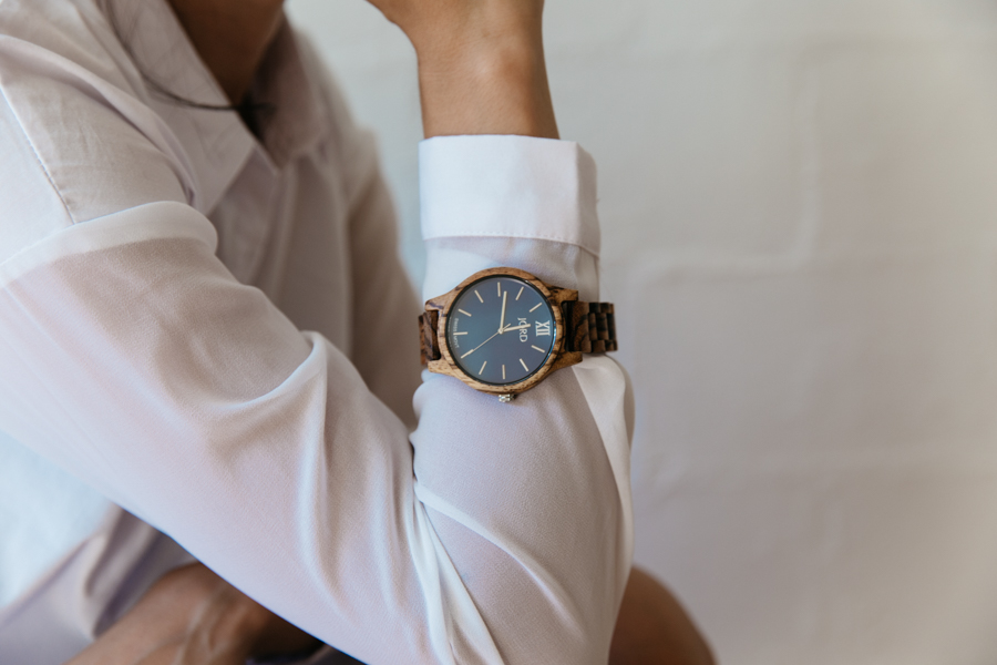 Jord Watches wooden watch with navy blue face.