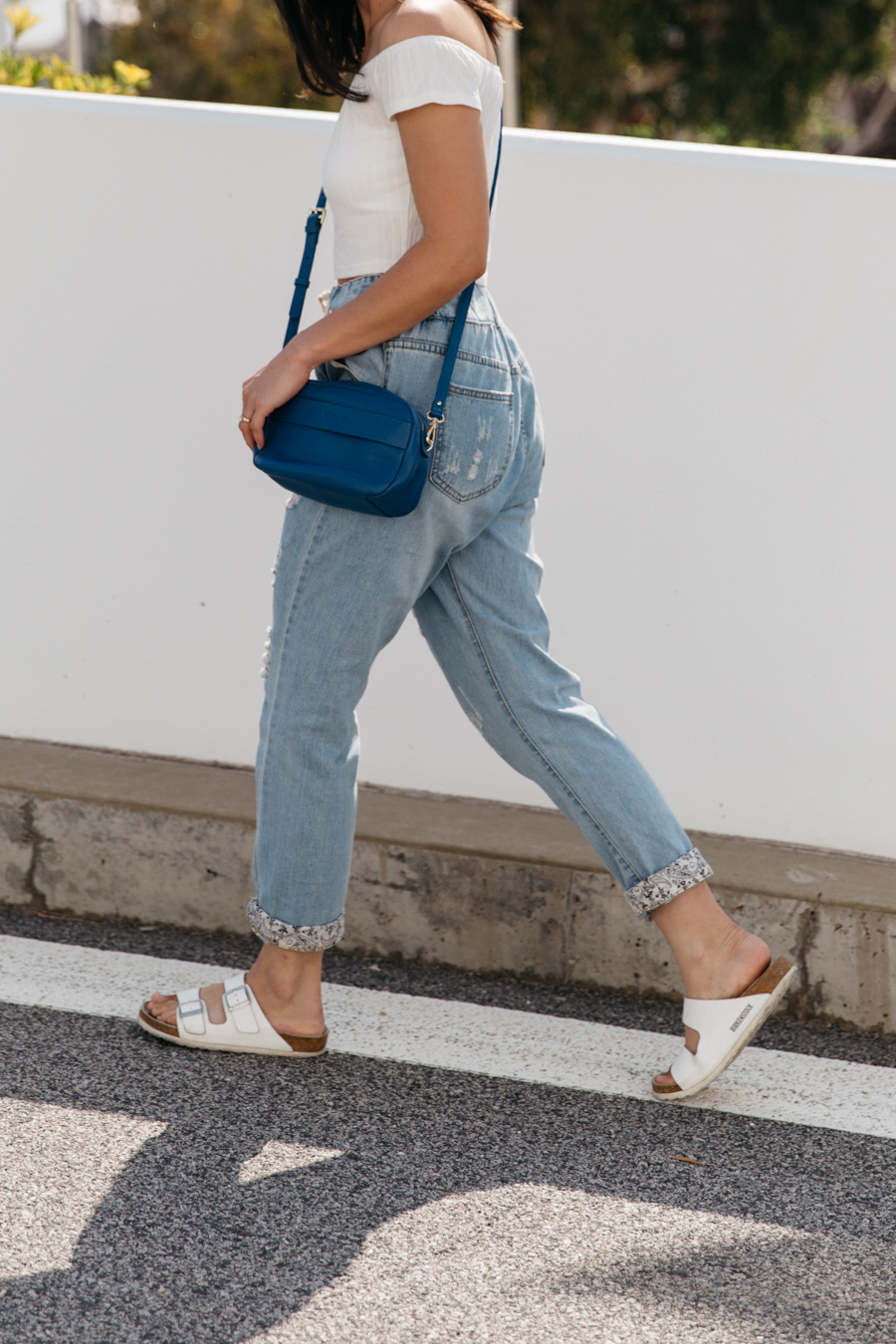 Drawstring boyfriend jeans with white Birkenstock sandals.