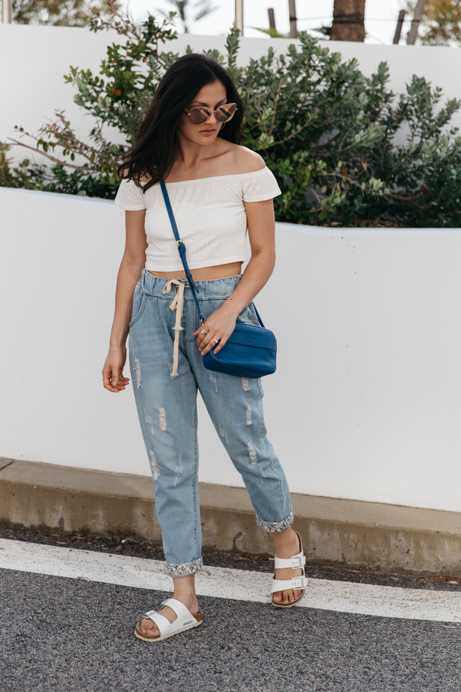 Drawstring boyfriend jeans outfit with crop top.