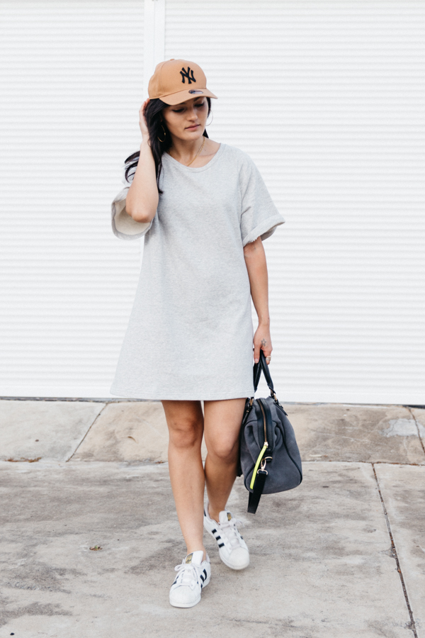 Dress with baseball cap outfit.
