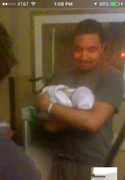 Daddy holding baby for the first time