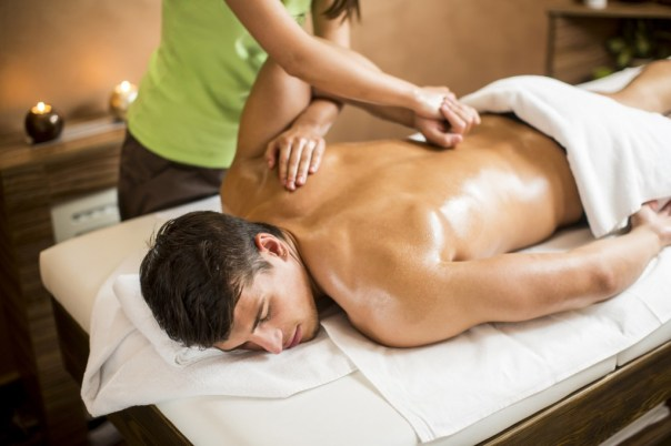 Young man having massage in spa