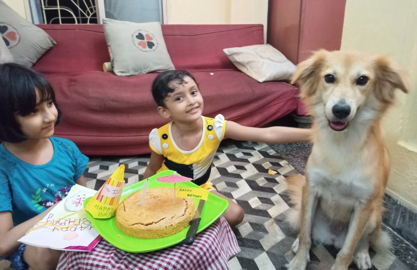 Dio poses with her peanut butter and carrot cake along with my two nieces who lovingly crafted a birthday card, cap and invites to mark the occassion.