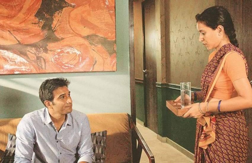 Ratna gives Ashwin a glass of water. Still from film