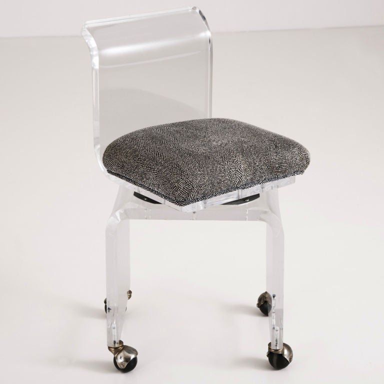 A Small Lucite Swivel Vanity Chair on Castors at 1stdibs