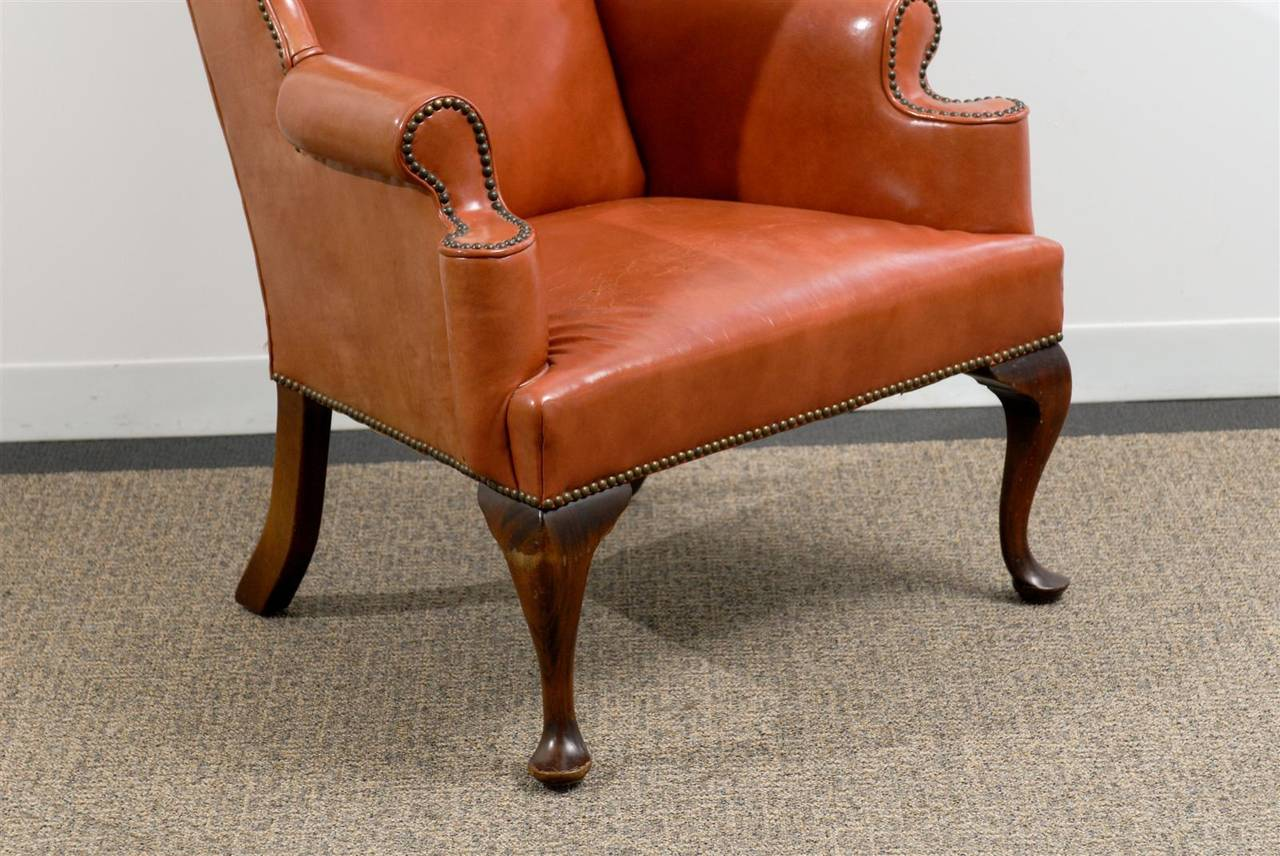 queen anne wingback chair leather value city dining table and chairs style wing in burnished orange